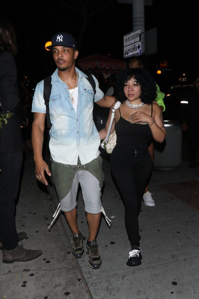 Rapper T.I. and wife Tiny are seen leaving the Delilah restaurant