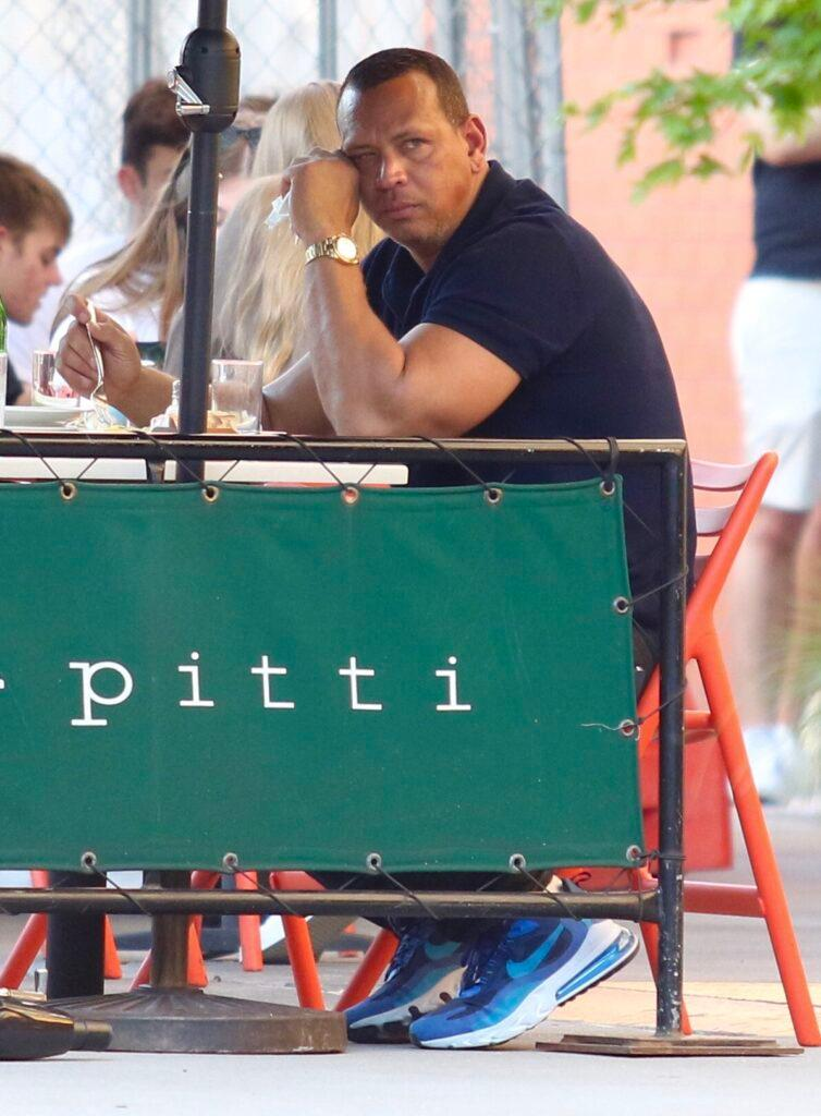 Alex Rodriguez looks sad as he eats alone at Bar Pitti Restaurant in NYC