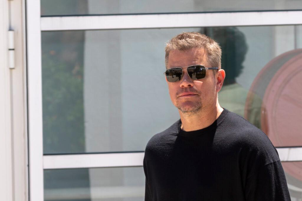 Matt Damon wearing sunglasses and a black shirt