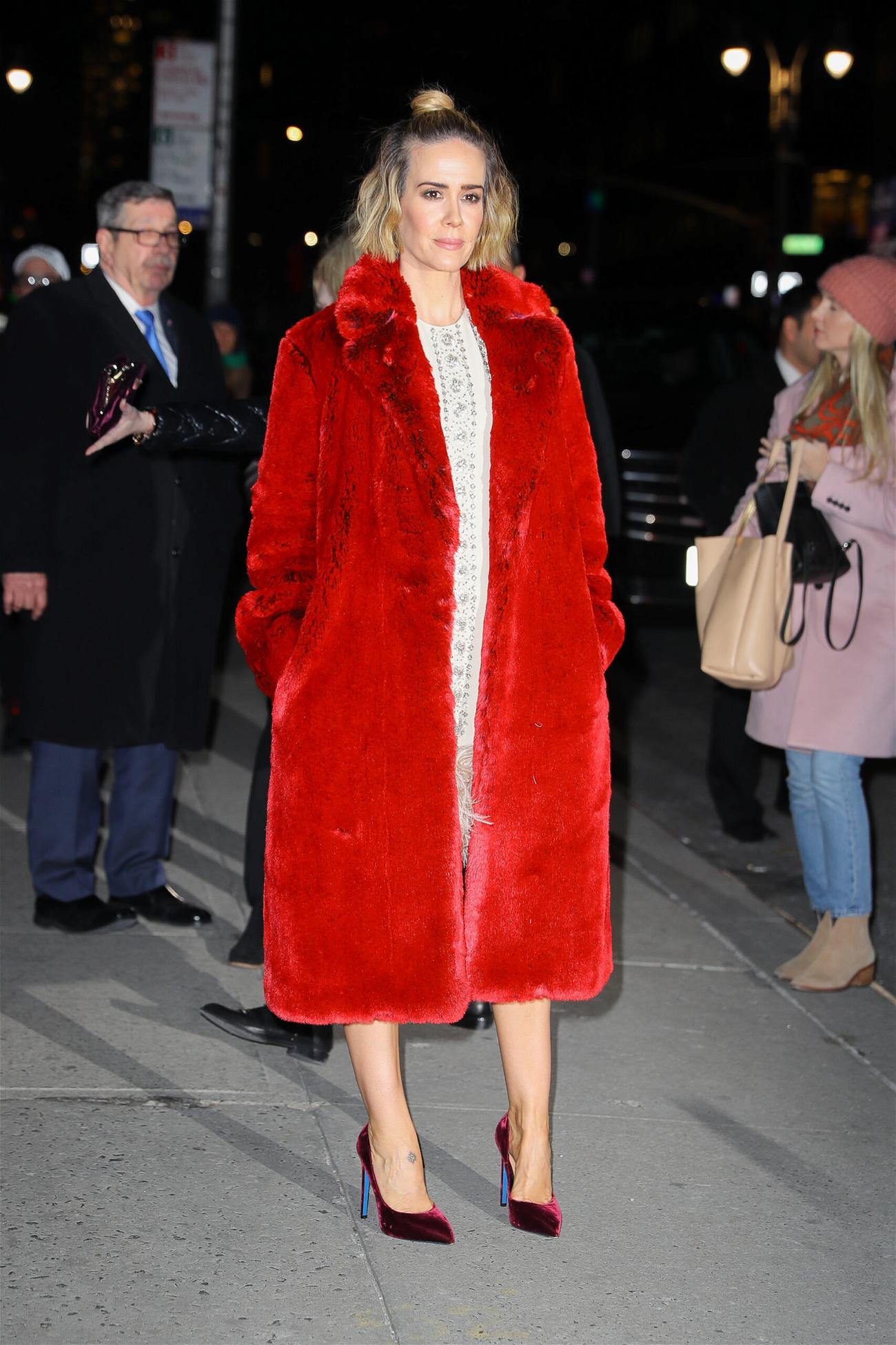 Sarah Paulson wears a red coat while arriving at The Late Show with Stephen Colbert in NYC on Jan 17 2019