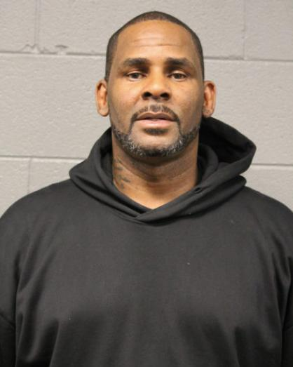 R Kelly looks poker faced in mug shot after being booked of sex abuse charges