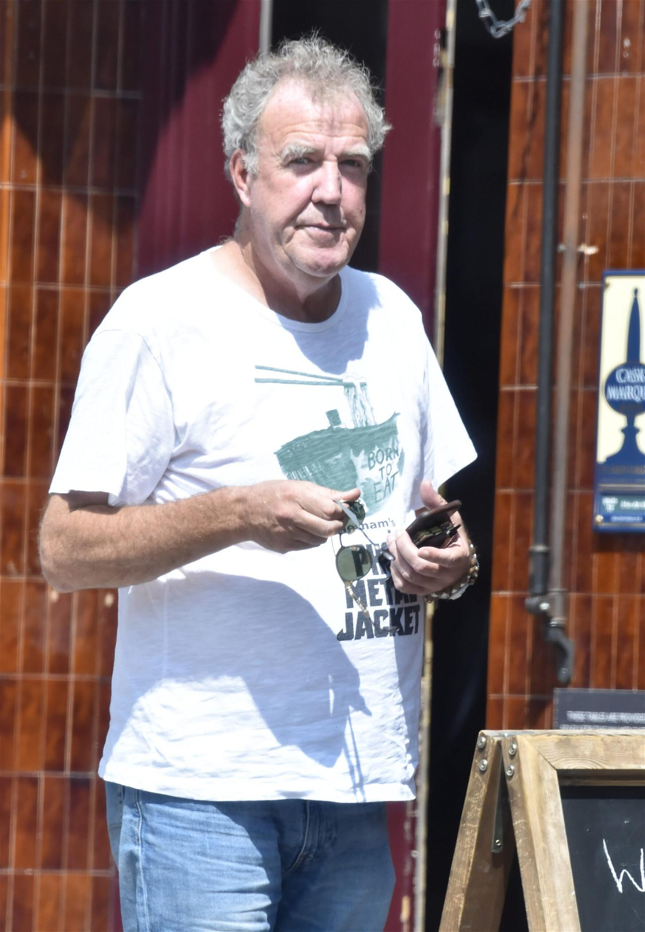Jeremy Clarkson is seen knocking back the Vino outside the Walmer Castle pub in Notting Hill
