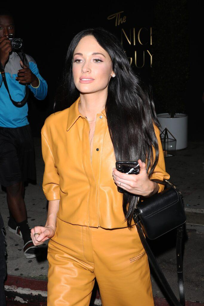 Singer Kacey Musgraves wears a all orange leather outfit as she leaves the Nice Guy