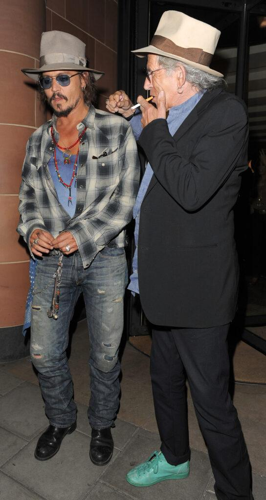Johnny Depp and Keith Richards both wearing fedora hats and sunglasses leaving apos C London apos restaurant Depp was sporting some cuts on his face and a rather painful bruise on his lower cheek