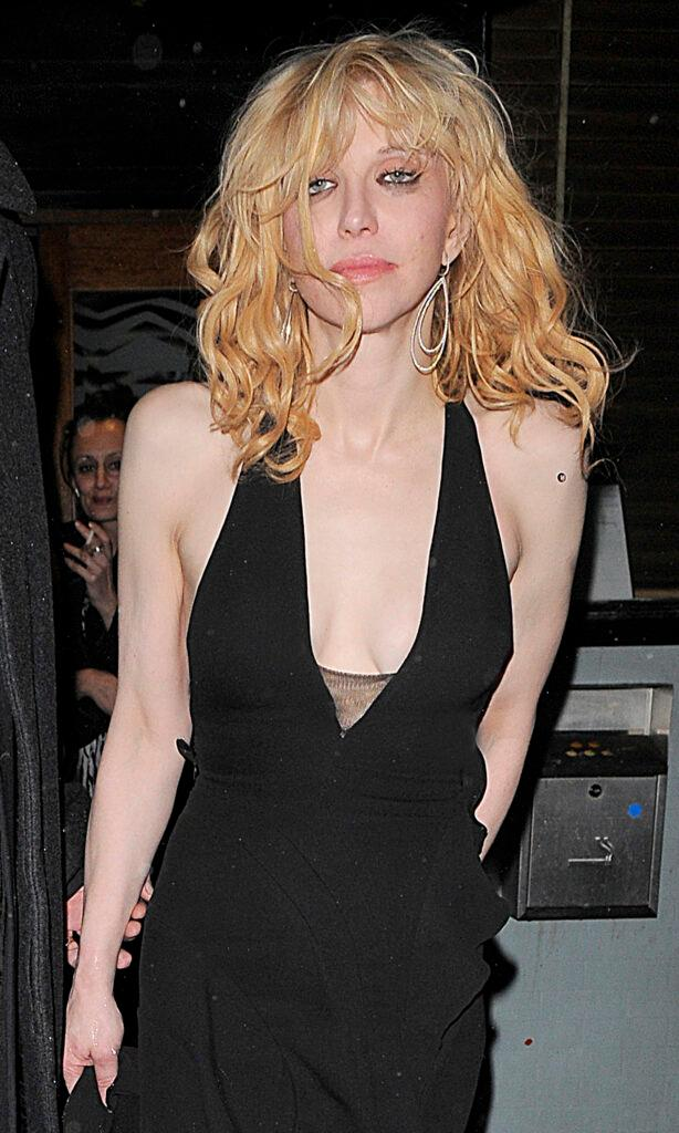 Courtney Love leaving the Groucho private members club at 2am appearing rather worse for wear As she arrived back at her hotel a member of staff attempted to block photographers taking pictures of Courtney by jumping in front of her