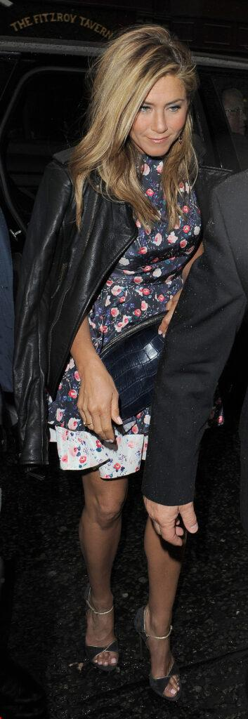 Jennifer Aniston arriving at Wahaca restaurant wearing a floral print dress