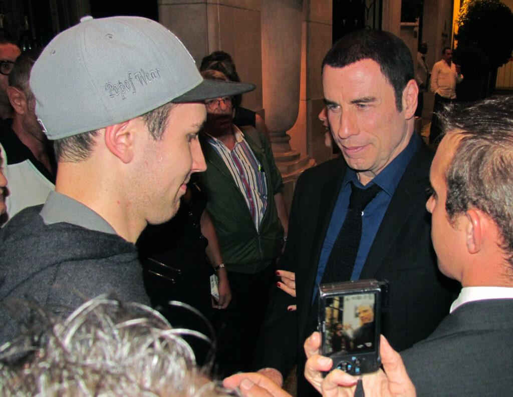 John Travolta and his wife Kelly Preston are shopping on avenue Montaigne in Paris