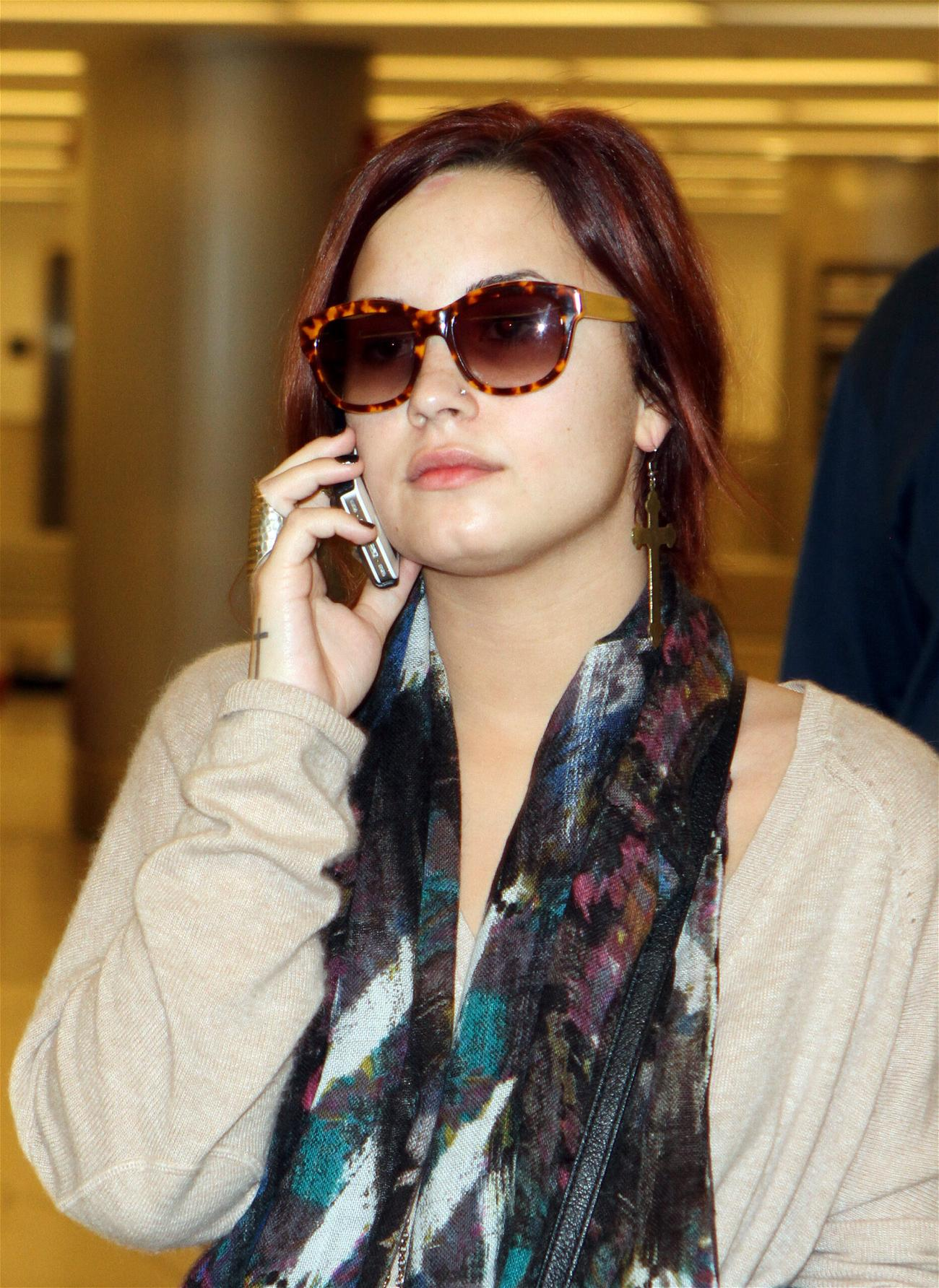 Demi Lovato arrives to Miami International Airport to perform a the Y-100 Jingle Ball