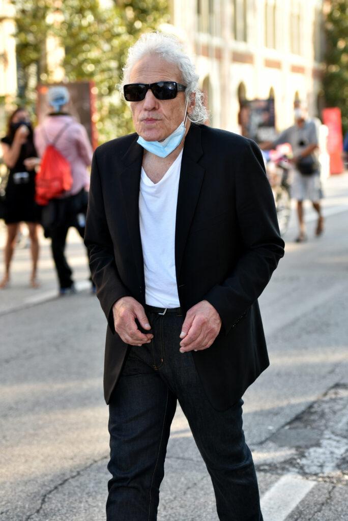 Abel Ferrara walks in the 77th Venice Film Festival