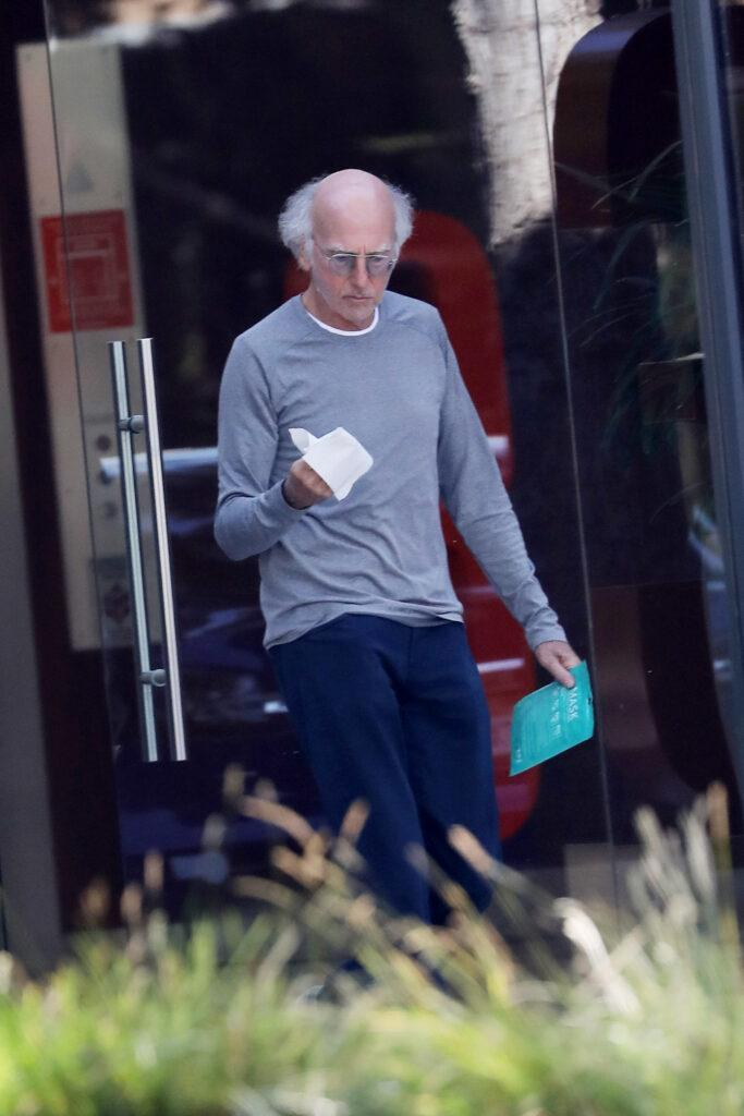 Newly wed Larry David coming out of an office building