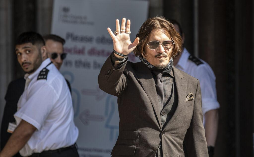 Actor Johnny Depp arrives at the High court in London as the legal action against The Sun newspaper continues