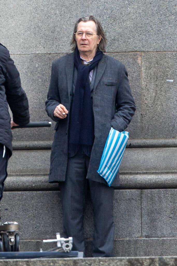 Gary Oldman joined his co-star Kristin Scott Thomas on the set of new Apple TV project Slow Horses in Westminster London on Tuesday