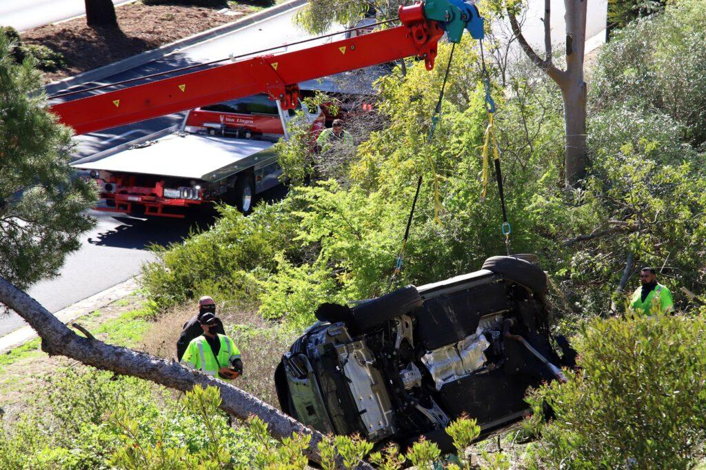 Tiger Woods car being recovered after the golfing legend had an accident at approximately 7 12 AM The road in Rancho Palos Verdes remained closed for hours as police carried out an investigation and a tow truck was bought in to take away the over turned