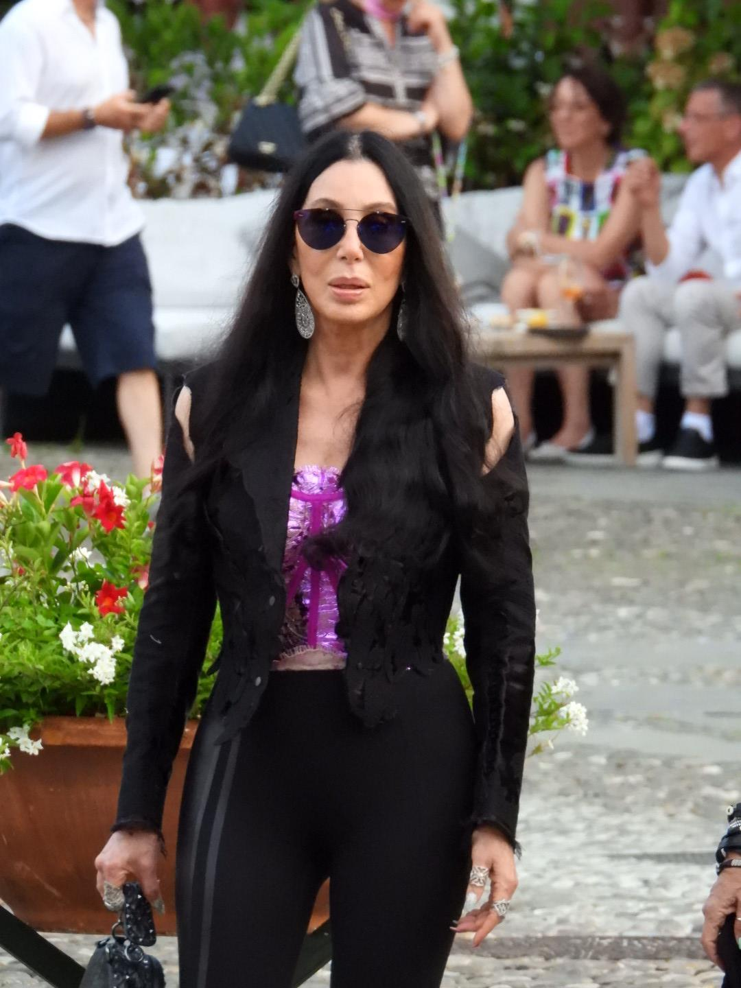 Cher is seen out for a walk with friends in the Italian resort of Portofino