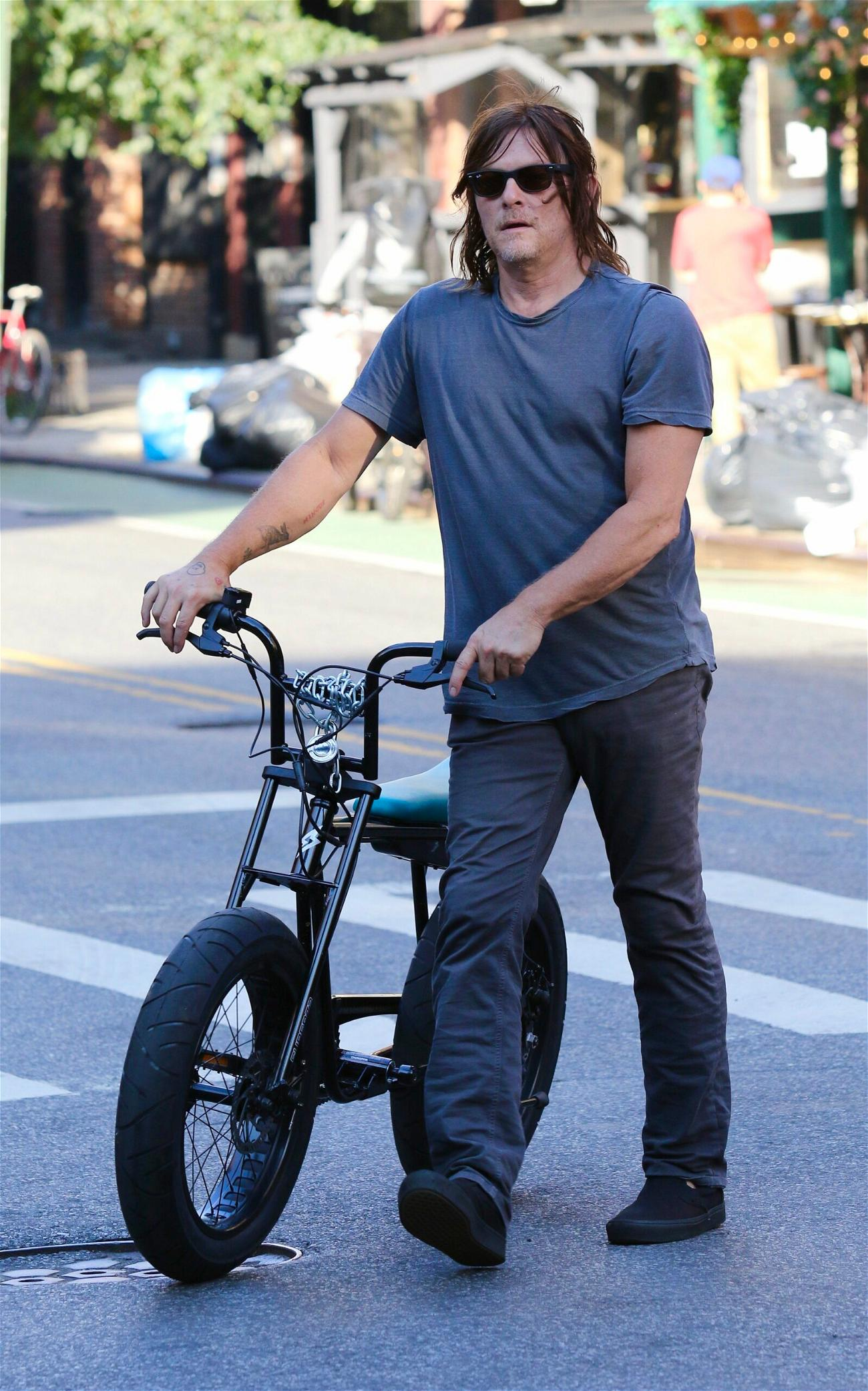 Norman Reedus walks home after a bike ride in NYC