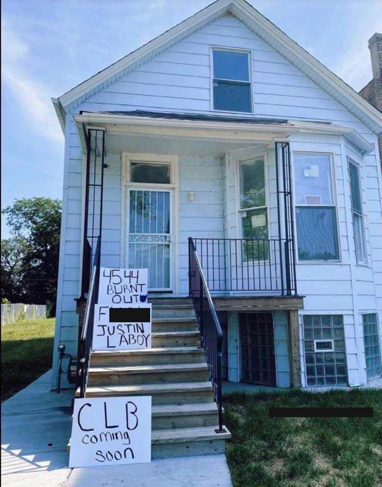 Drake fans leave signs at Kanye's childhood home.