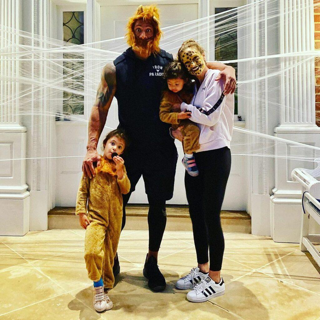 A beautiful family portrait showing Dwayne Johnson, Lauren Hashian, and their two kids, all disguised in lion outfits.