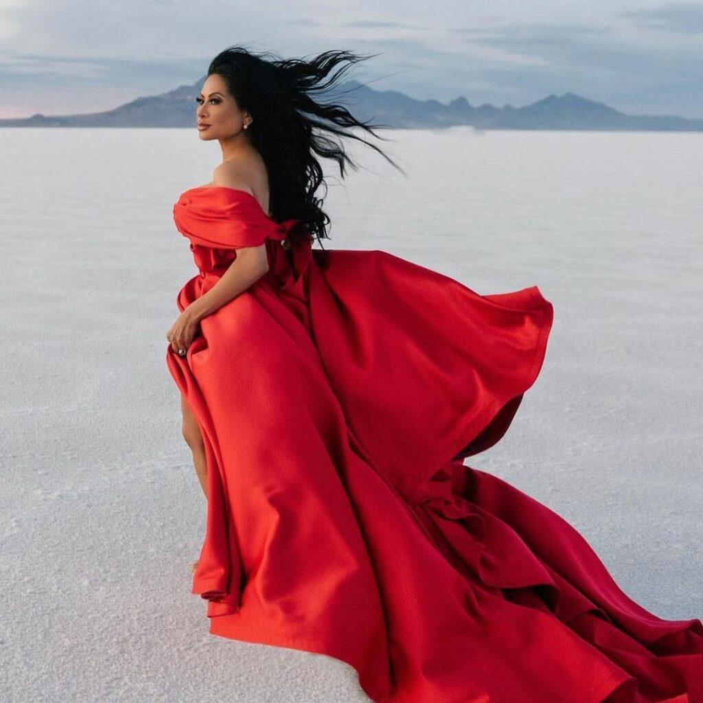 A photo showing Jen Shah in a bright red dress.