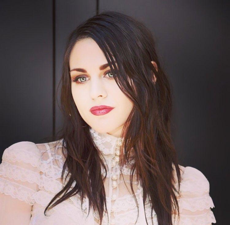A beautiful looking Frances Bean Cobain sporting a pink net outfit.
