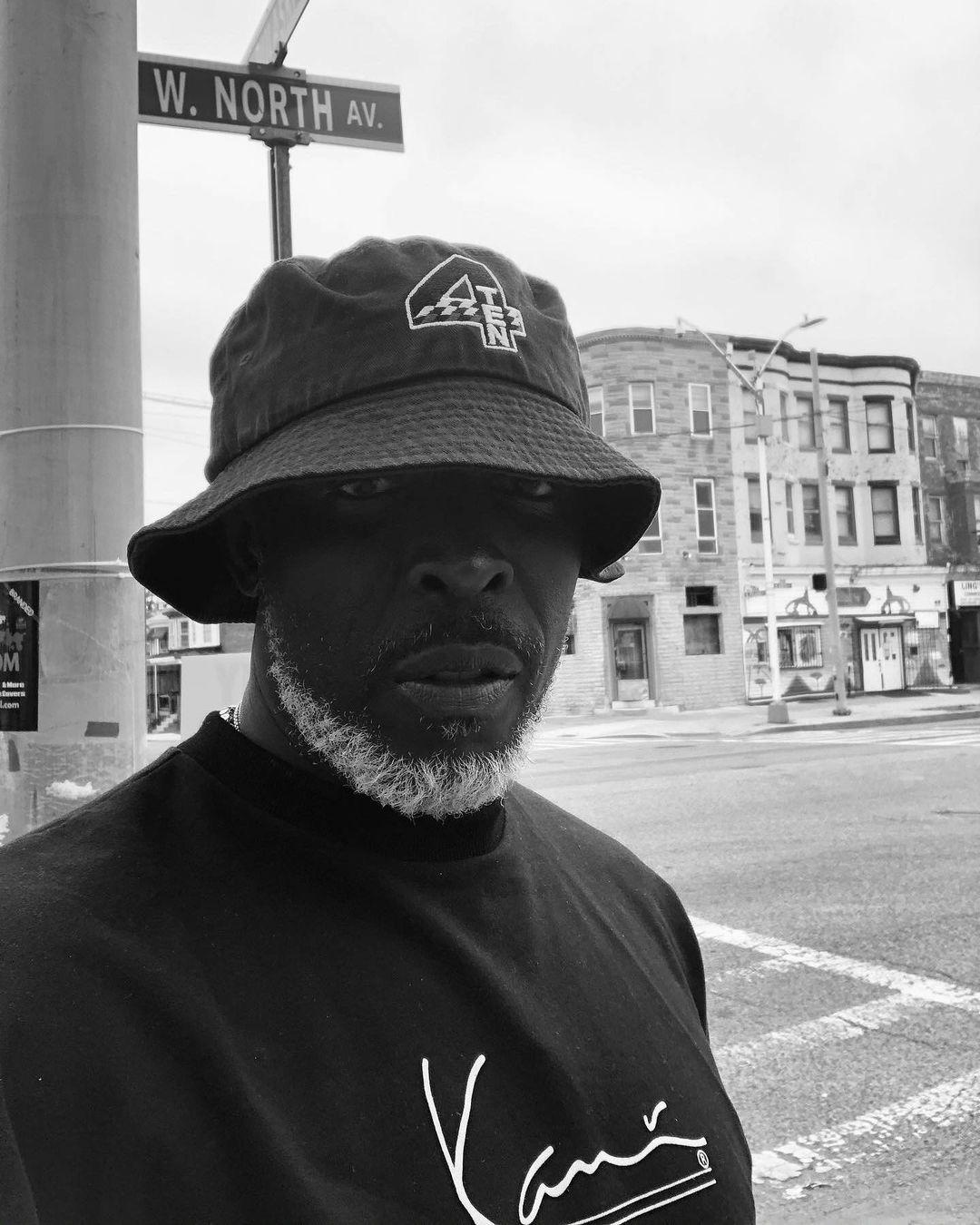 A black and white themed photo showing Michael K Williams