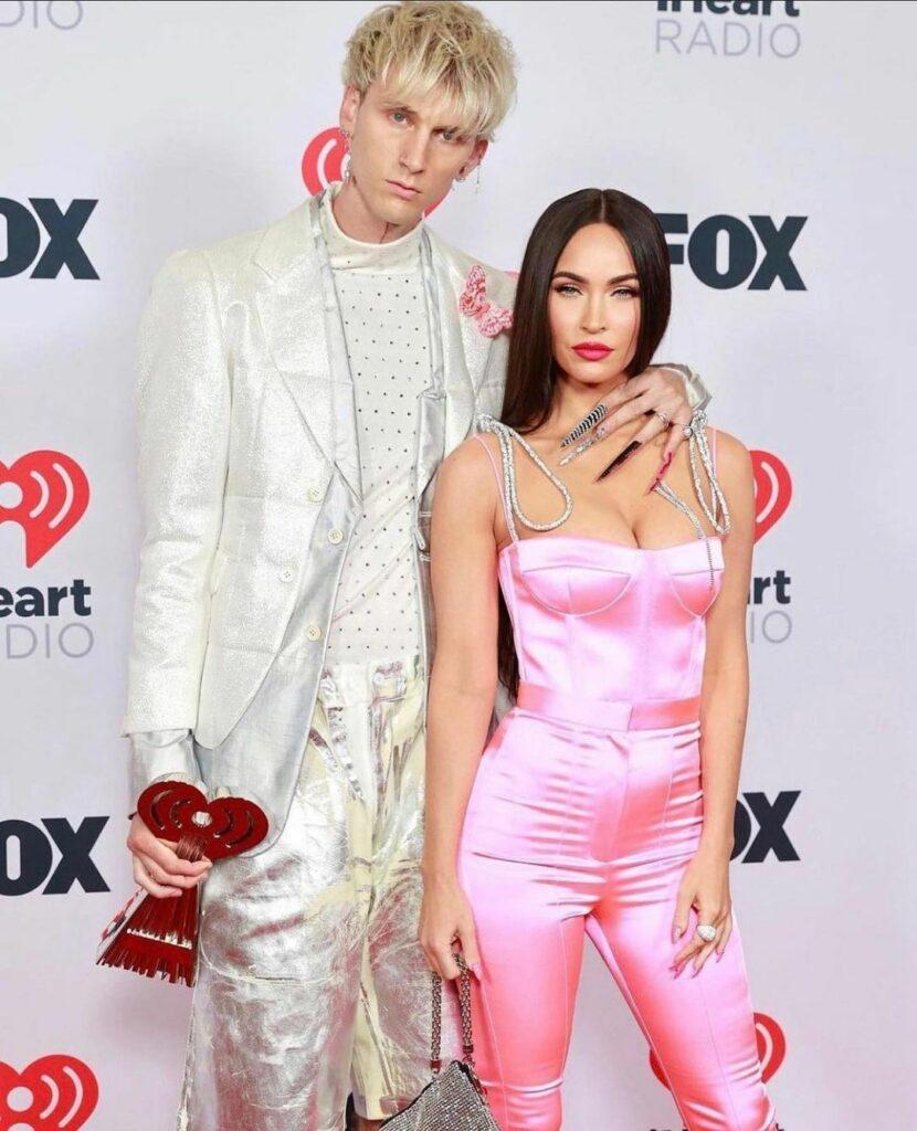 A photo of Machine Gun Kelly and Megan Fox all dolled up at an event