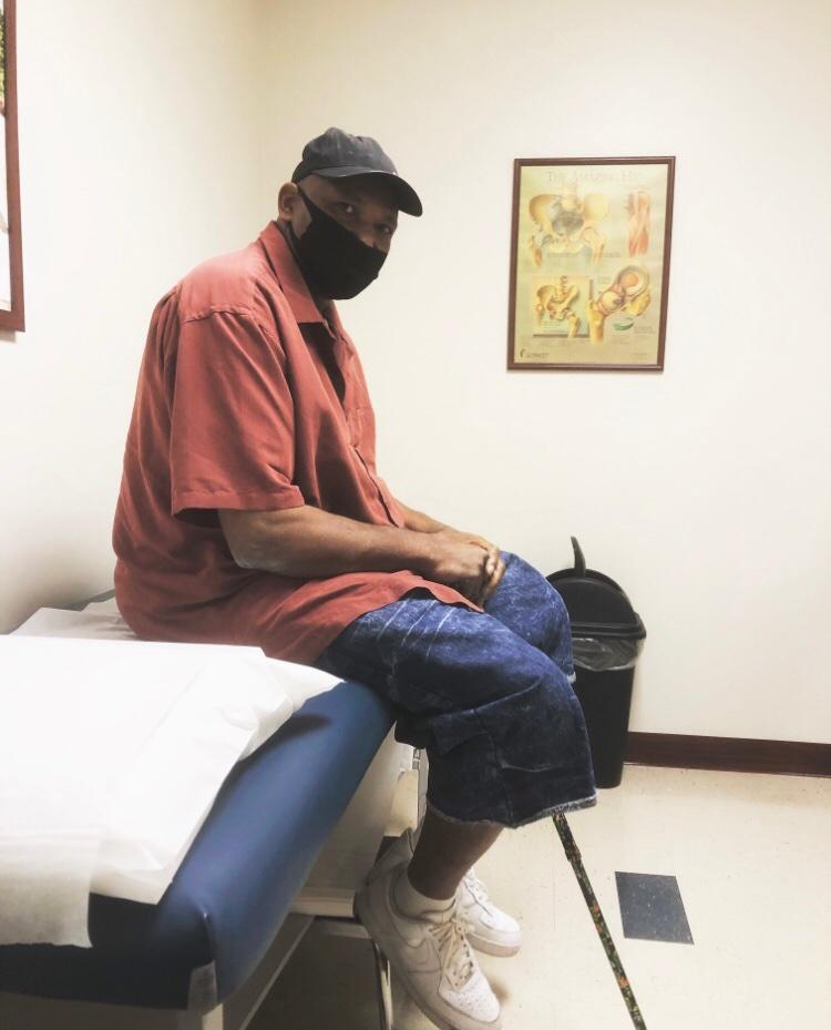 A photo showing Keith McCants sitting in a room.