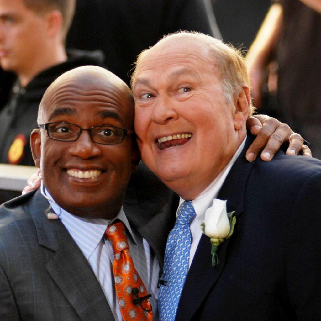 Al Roker and Willard Scott smiling at the camera beautifully at an event.