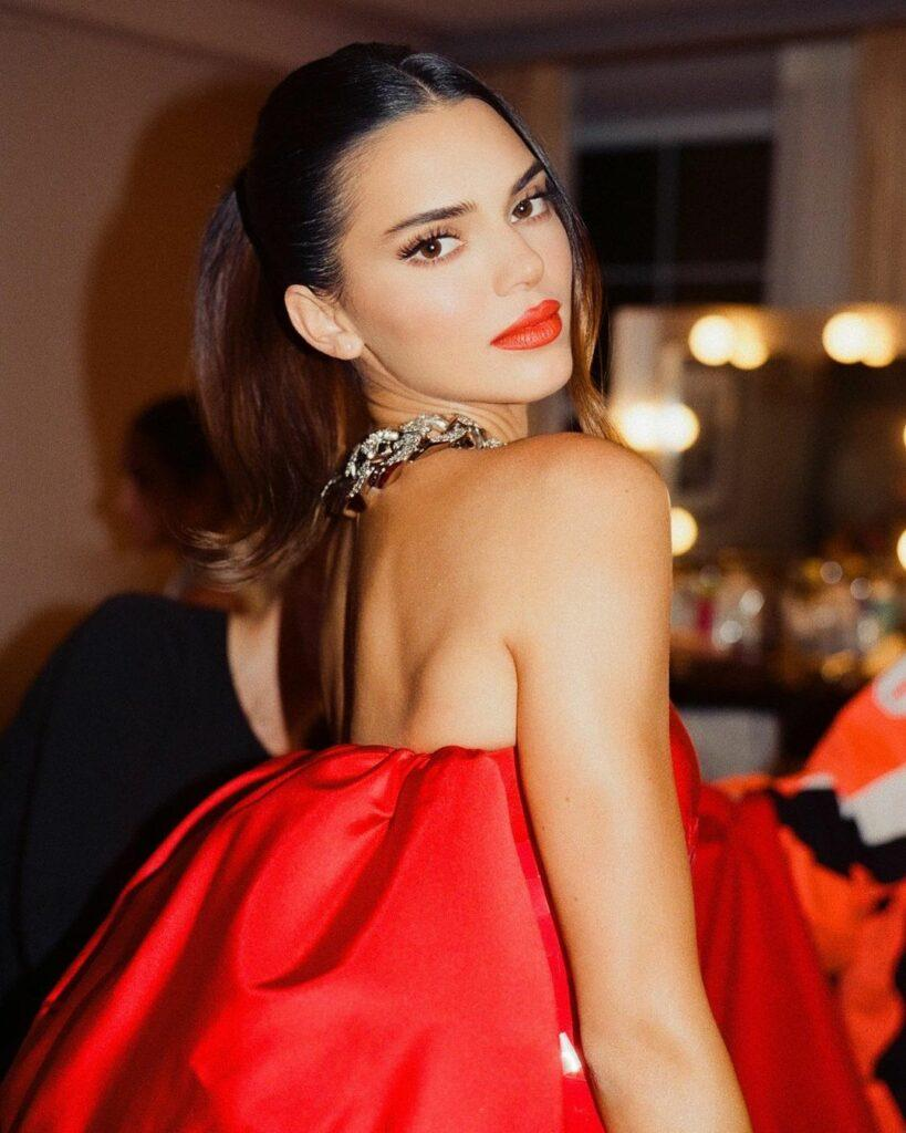 A lovely photo showing Kendall Jenner in a red strapless dress.