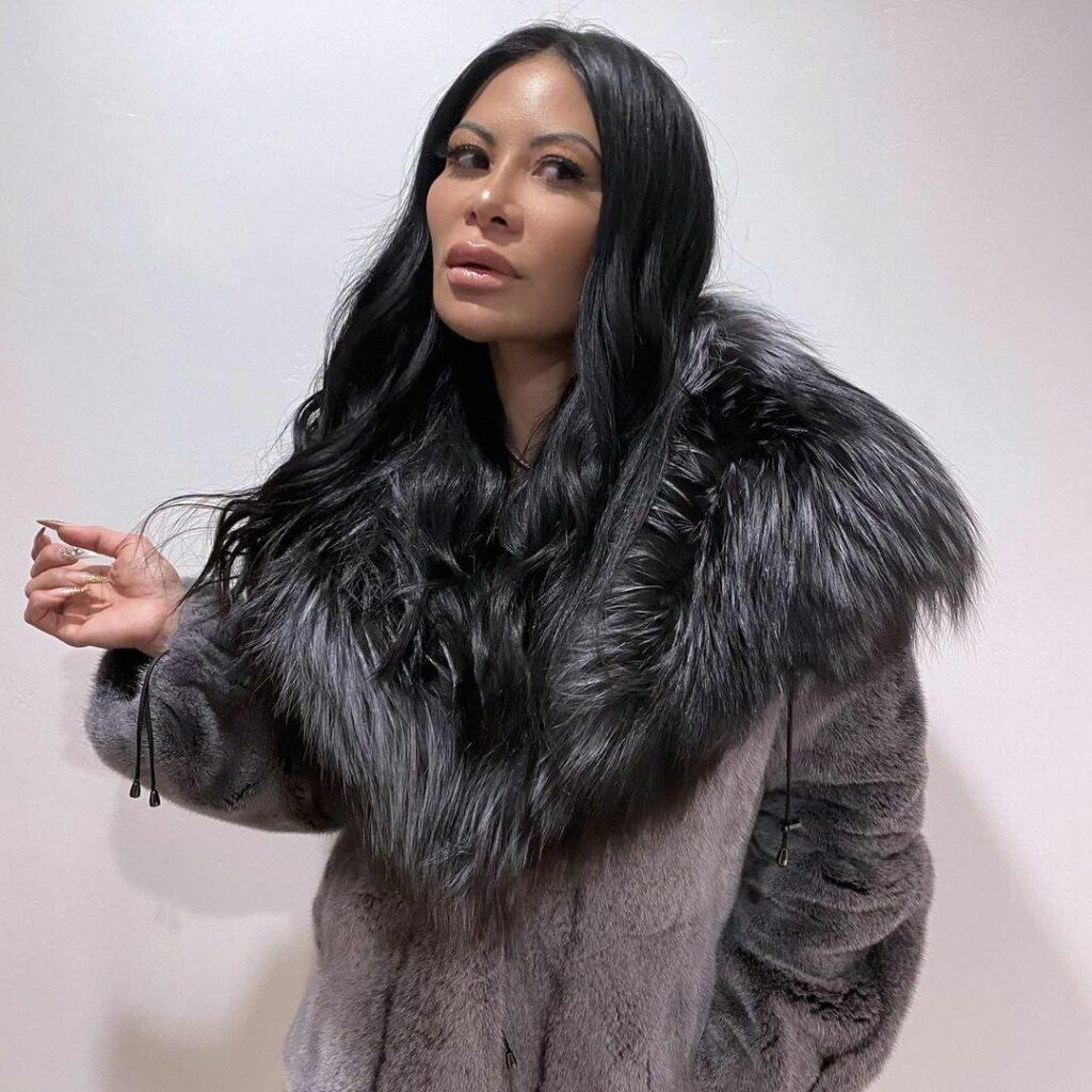 A photo of Jen Shah in a gray fur coat, and she looks gorgeous.