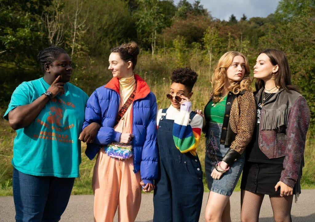A photo showing some cast of Netflix's 'Sex Education' movie during a scene.