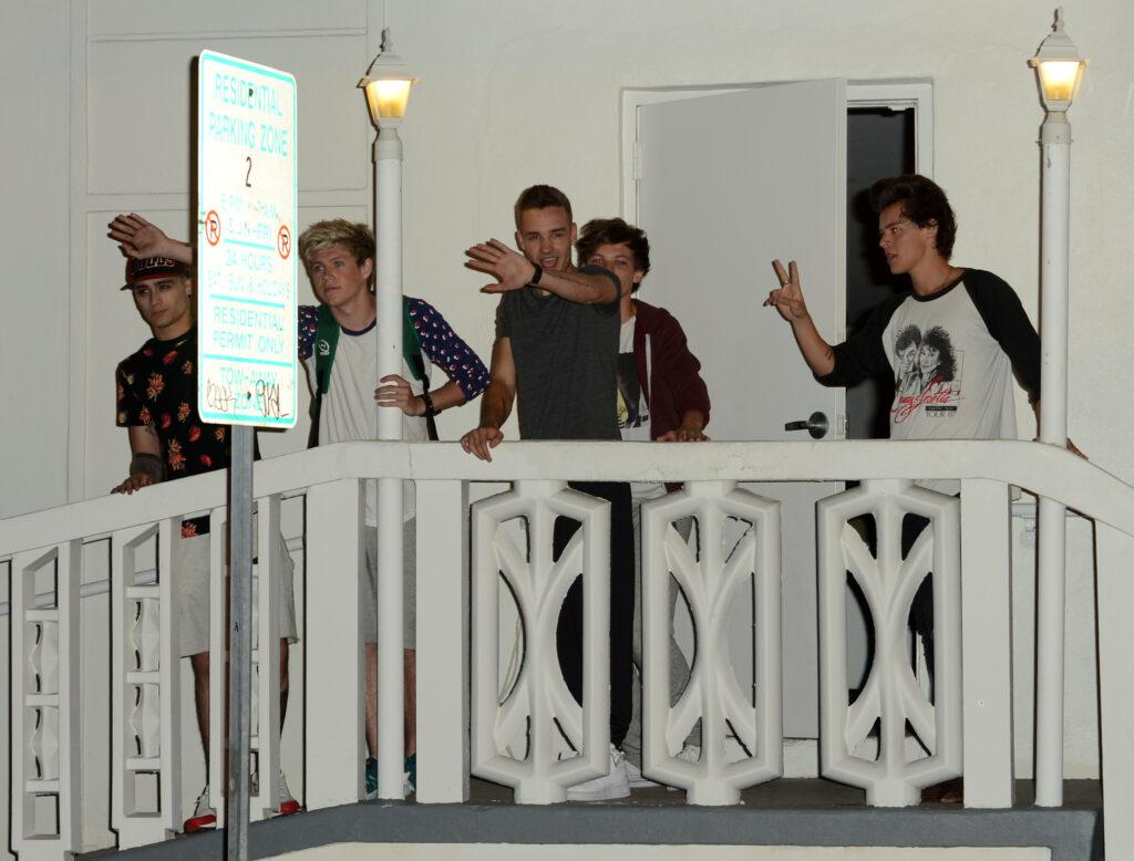 One Direction on a balcony