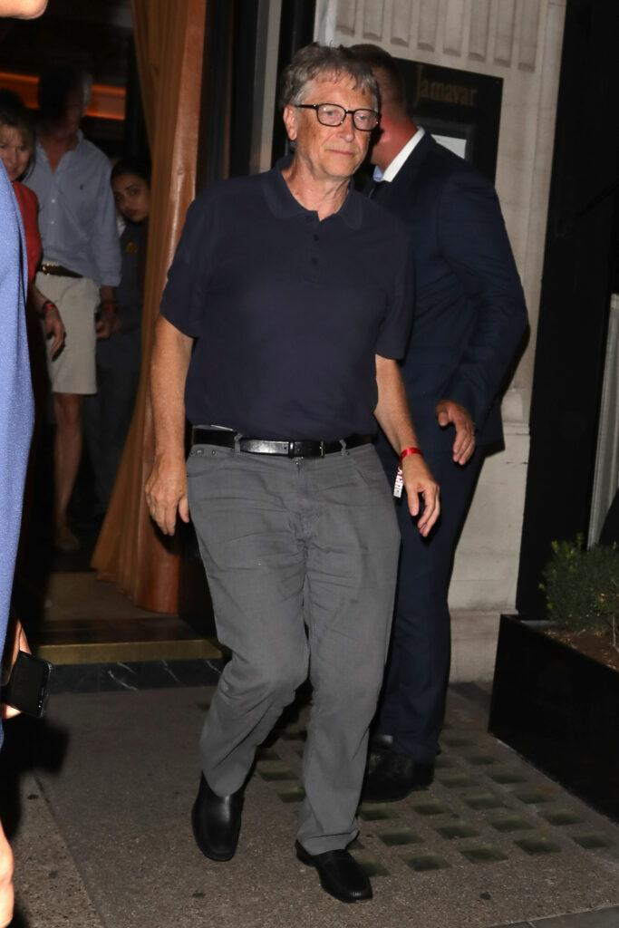Microsoft Founder Bill Gates stumbles on a step as he leaves Jamavar in Mayfair after dining with friends