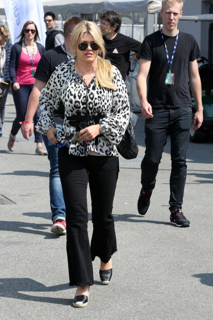 Corinna Schumacher with daughter Gina Maria and boyfriend in Monza