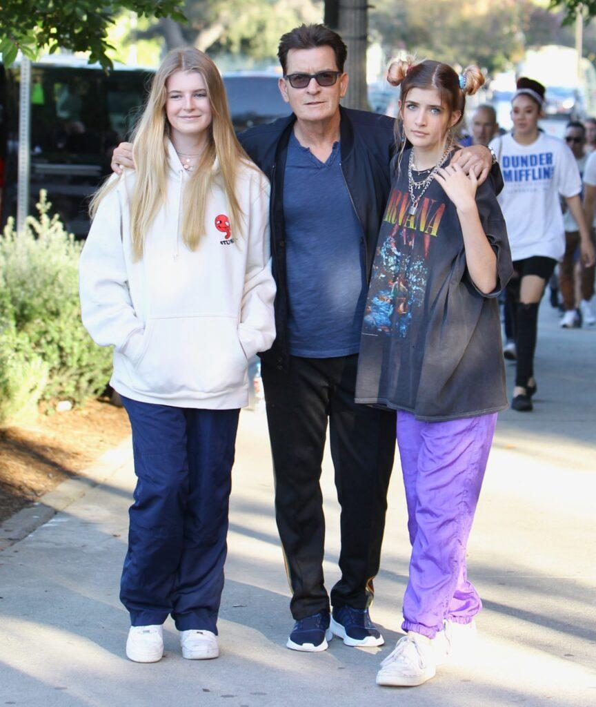 Charlie Sheen searched by security at the Billie Eilish concert and removes a clear container containing colored tablets