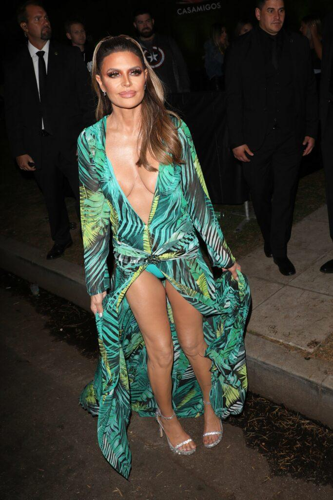 Lisa Rinna dresses up as Jennifer Lopez in a green Versace dress as she goes to the 2019 Casamigos Halloween Party