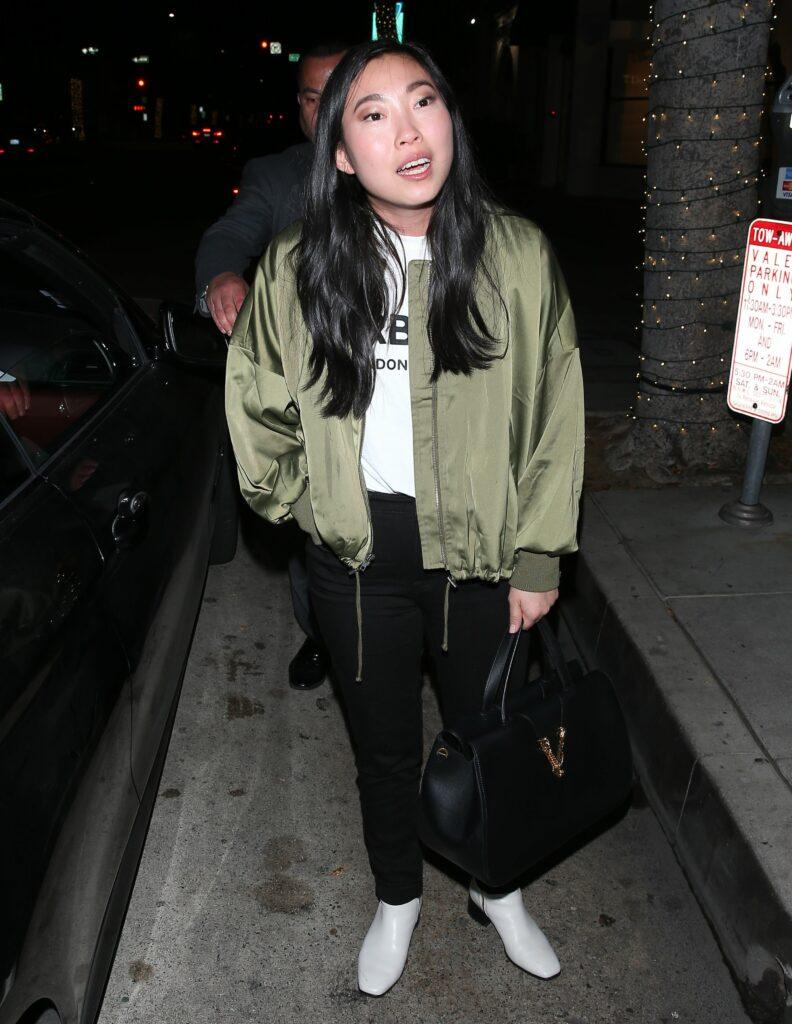 Awkwafina was seen leaving dinner at apos mr Chow apos in Beverly Hills
