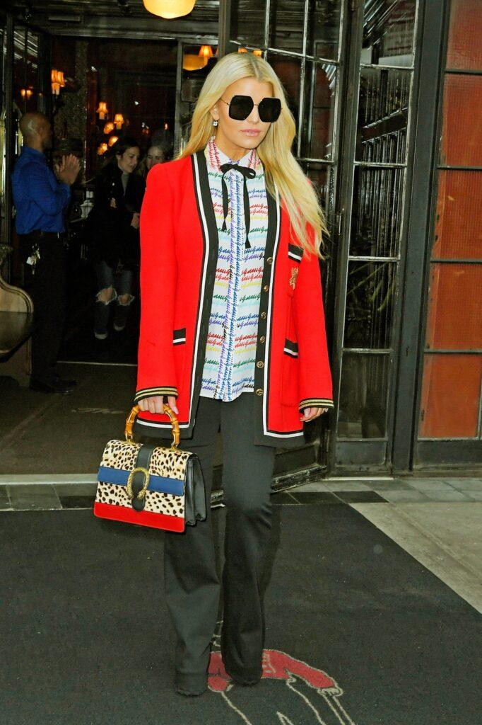 Jessica Simpson heads out from her hotel in all Gucci outfit