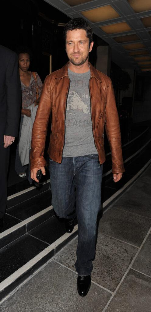Gerard Butler leaving his hotel to go for dinner at Hakkasan restaurant He spent around two hours inside and wore a brown leather jacket grey t-shirt and jeans for the low key outing