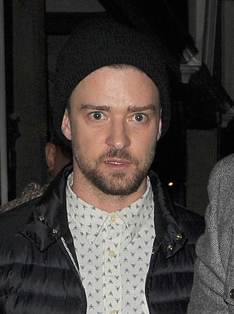 Jessica Biel and husband Justin Timberlake emerge from Dover Street Market having spent just over two hours inside Jessica smiled as she left the store but Justin appeared rather worn out and hid behind a burly minder