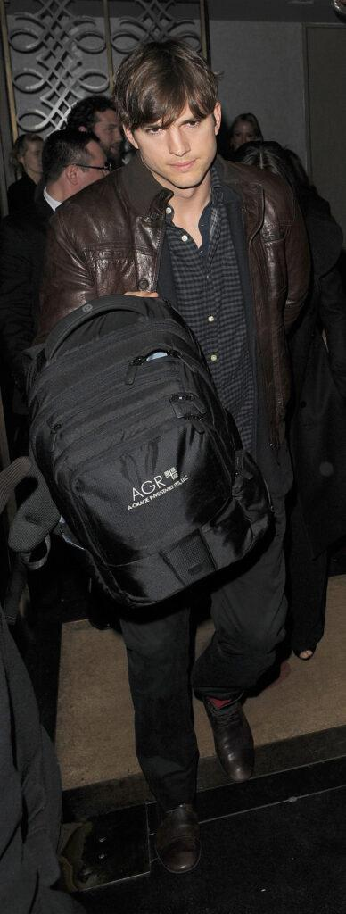 Ashton Kutcher and Mila Kunis appear very camera shy as they leave Scott apos s restaurant in Mayfair