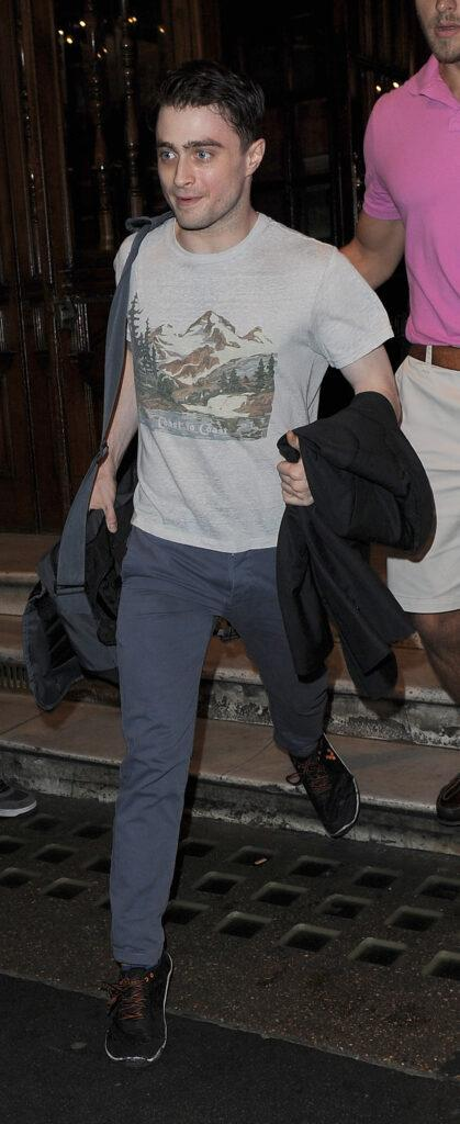 Daniel Radcliffe leaves the Noel Coward Theatre having performed in apos The Cripple Of Inishmaan apos The Harry Potter star was wearing blue trousers a grey t-shirt and black trainers He appeared rather wide eyed and sweaty