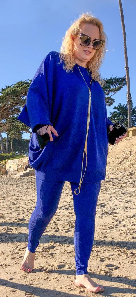 Rebel Wilson takes a walk on the beach