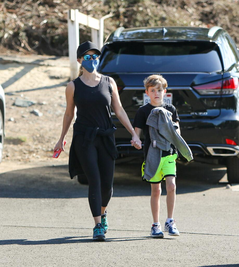 Reese Witherspoon walks the dogs with her kids