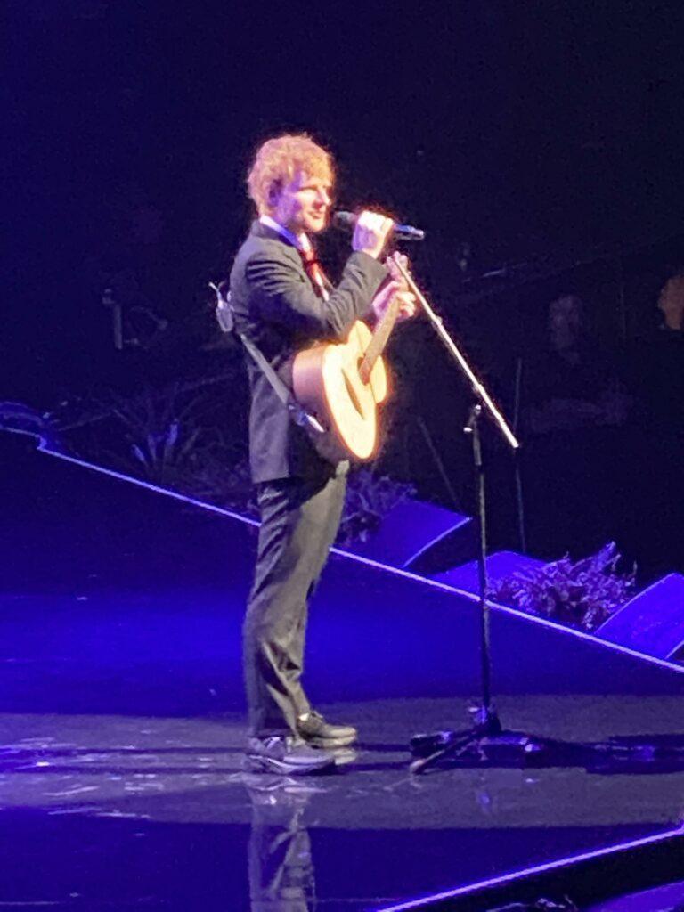 Ed sheeran performing at Michael Gudinski funeral