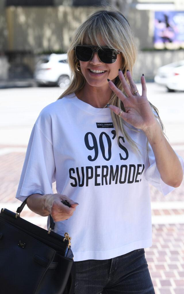 Heidi Klum flashes a peace sign while heading back to work on America apos s Got Talent in a 90 apos s Super Model T-shirt
