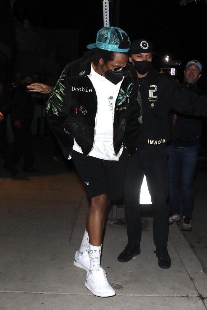Jay-Z enters a Tesla leaving dinner at Giorgio Baldi