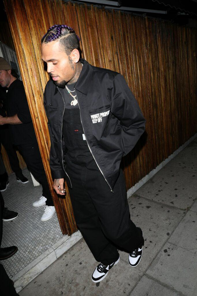 Singer Chris Brown is disappointed as he leaves the Nice Guy after a driver crashes into another car which hits his car