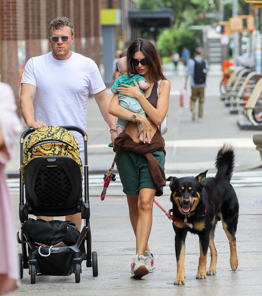 Emily Ratajkowski is all smiling while carrying her Baby as they taking a stroll with husband Sebastian Bear-McClard in NYC