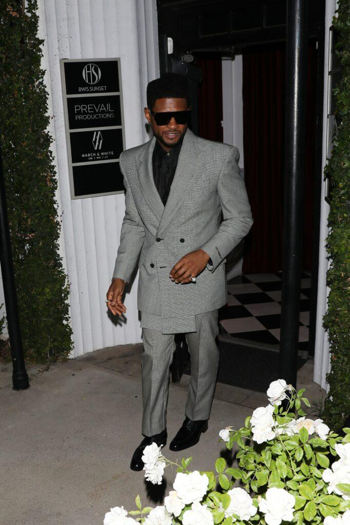 A well dressed Usher attends Justin Bieber apos s apos Freedom Art Experience apos art gallery