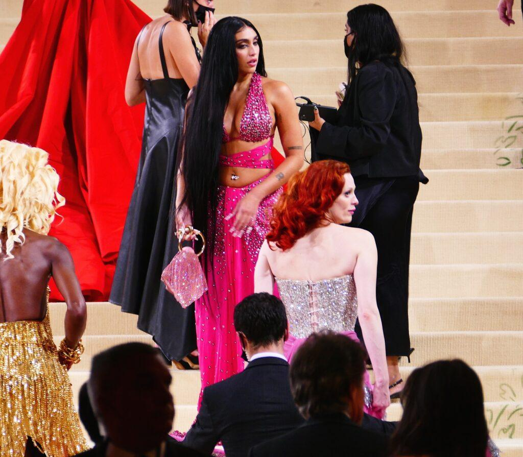 Madonna apos s daughter Lordes gives a sharp look to one of J Balvin apos s extra invited guests as she takes over the carpet a bit to close to her space at Met Gala